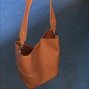 Cute tan bucket shoulder bag!
